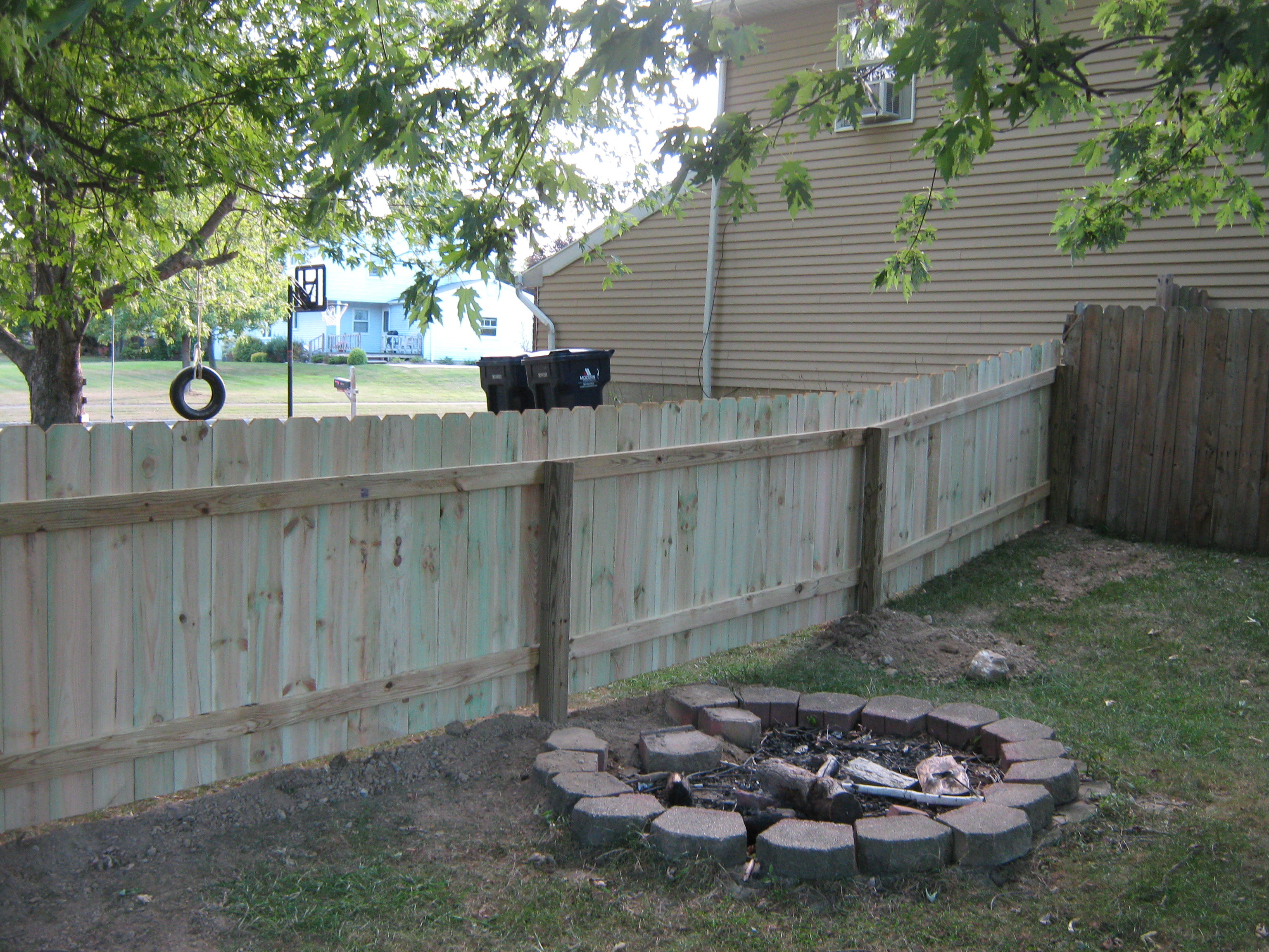 Pressure treated sadler fence and staining llc photo 4 foot high straight top dogear fence with flat top posts baanklon Images