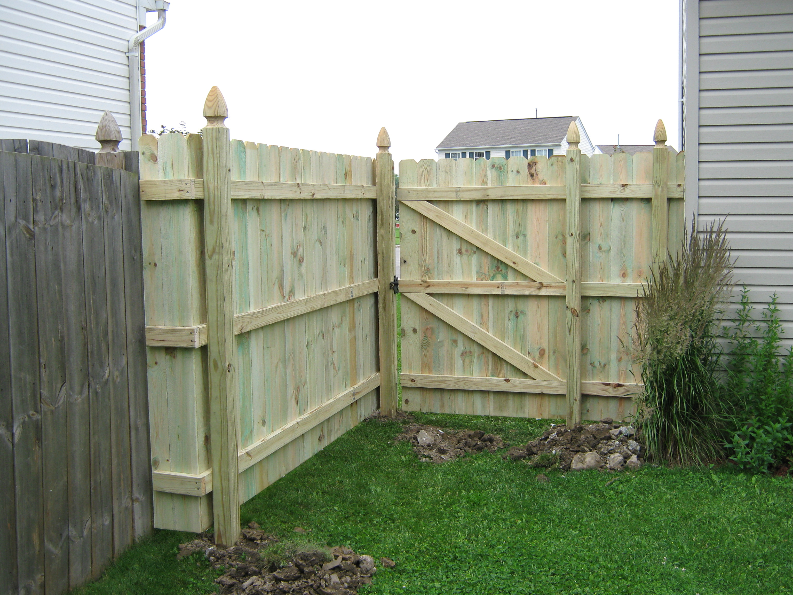 Pressure treated sadler fence and staining llc photo 6 foot high straight top dog ear fence with french gothic posts baanklon Gallery