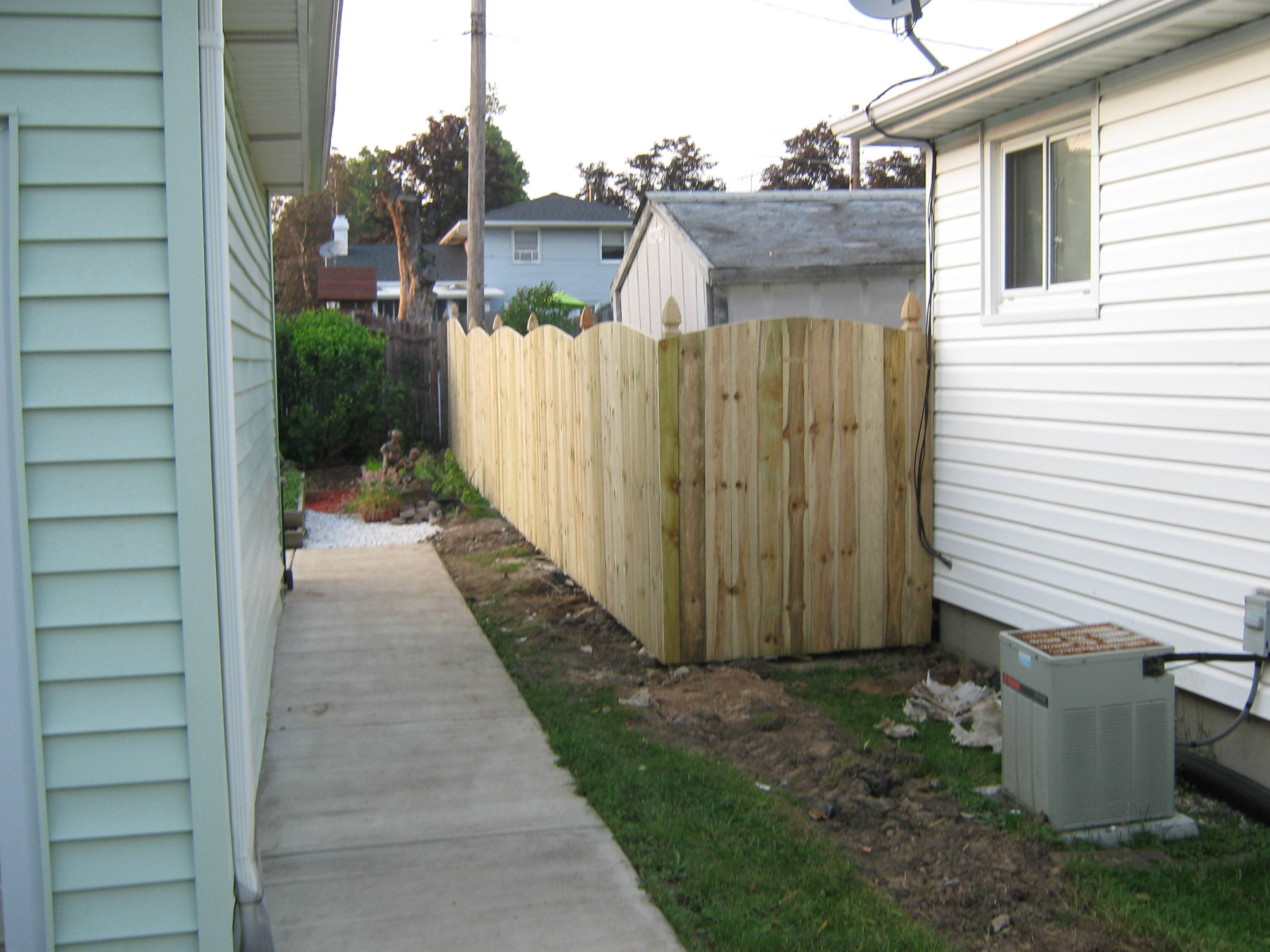 photo 6 foot high convex fence with french gothic post tops