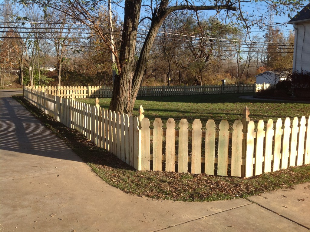 3 foot high pressure treated spaced picket fence. Gothic top pickets and posts.