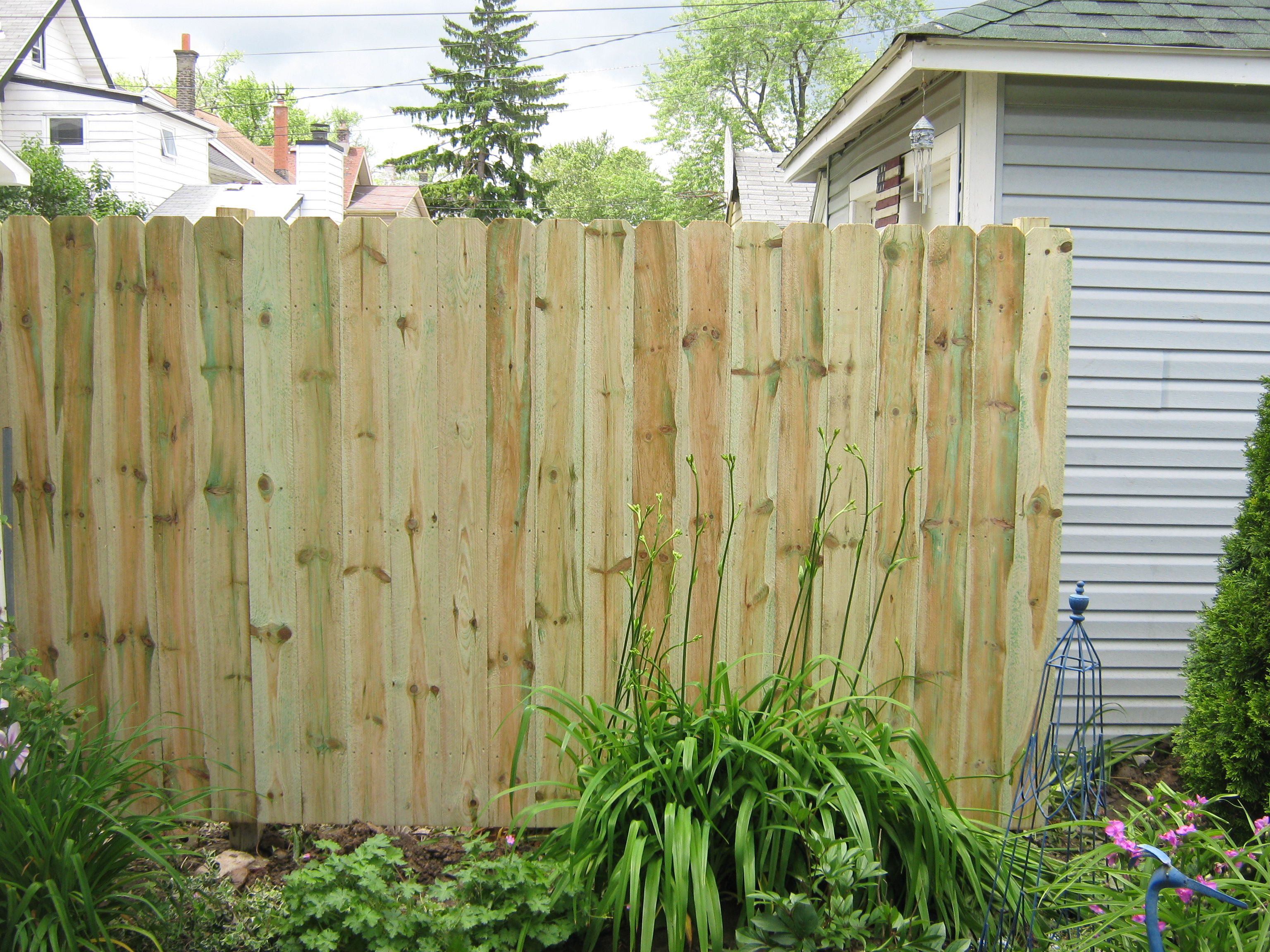 how to clean pressure treated wood fence